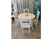 John Lewis round pine table with four chairs