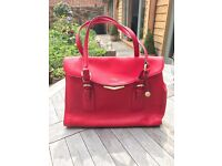 Fiorelli handbag, large. flap closure. mid length handles.