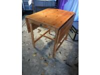 small table, seats 4 with little drawer and two chairs with cushions for sale