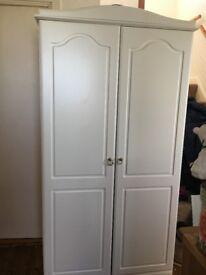 White, double door wardrobe with internal mirrors