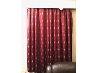 2 pairs of deep red curtains with gold leaf detailing.
