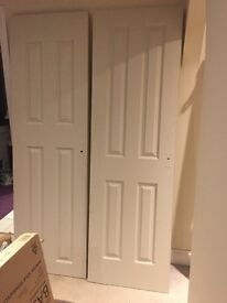 Two 4 panelled pre-primed doors already cut for handle