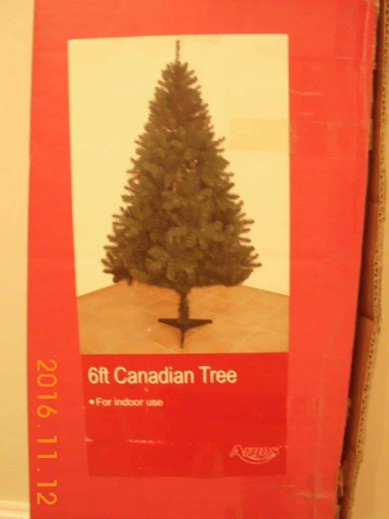 CHRISTMAS TREE ARTIFICIAL CANADIAN 6FT WITH INTEGRAL BASE. IN EXCELLENT CONDITION AND ORIGINAL BOX.