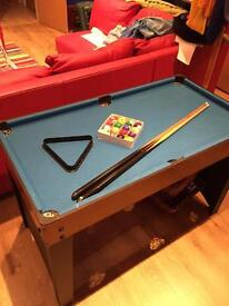 Child's pool table with a separate table football top
