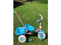 Girls' trike in new condition with handle and rear'bucket'. Grandparents selling.