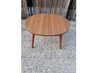 small brown wood top oval coffee or side table