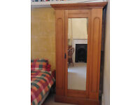 Antique pine wardrobe with full length mirror, hanging rail, shelf and 3 brass hooks