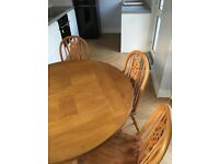 Solid oak circular table and oak chairs