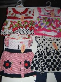 Four three piece dresses all baby C. and socks and tights all new