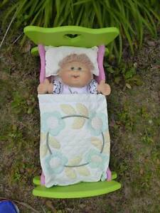 Wooden Rocking Cot with bedding and Cabbage Patch Kid Pearsall Wanneroo Area Preview
