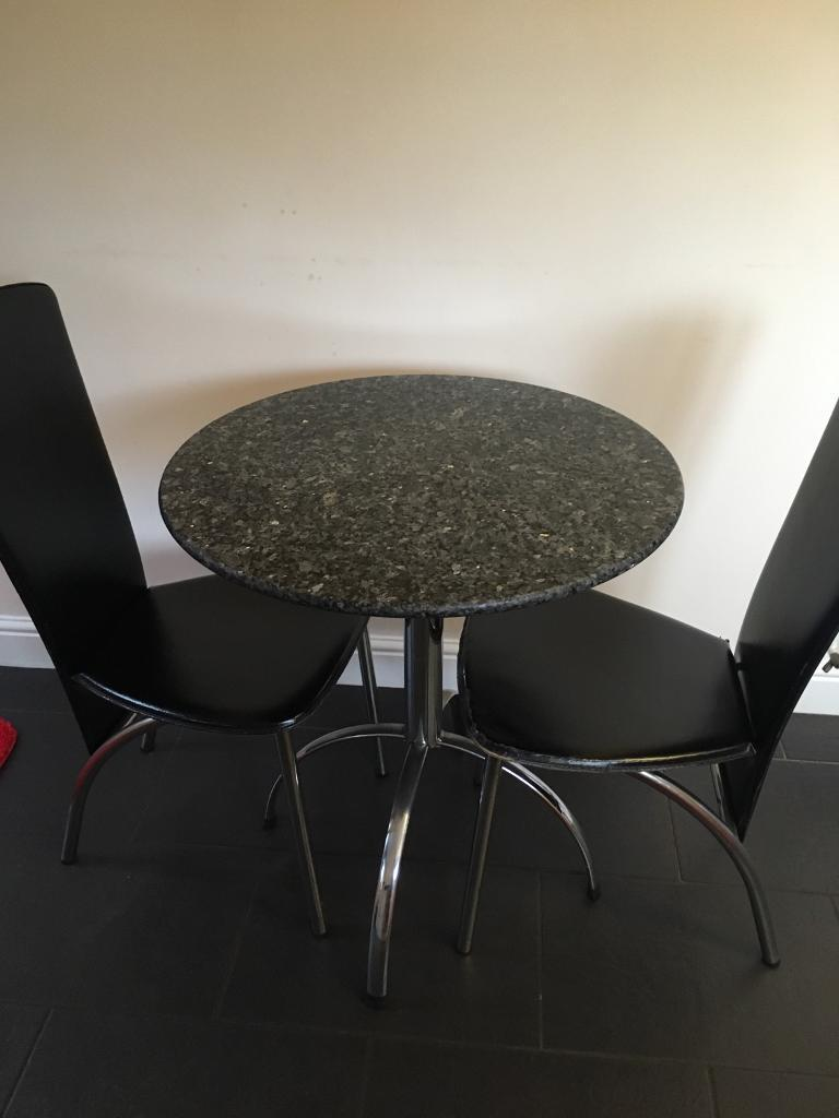 Granite dinning table and 2 leather chairs