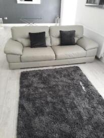 2 & 3 seater light grey leather sofas. Still with tags.