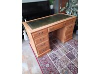 Pine pedestal desk with leather top.