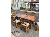 High quality rustic sold oak plank table and six chairs