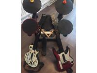 Wii + Guitar Hero + Drum Kit + 2 Guitar/Bass with 9 games and 4 controllers