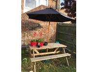 Garden bench with umbrella