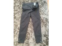 M & S UK 14 Super slim Grey soft touch trousers with zips on the ankles. Brand new with tags. £4. To