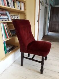 Four dark red dining room chairs