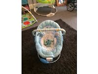 Baby boy bouncer plays music and vibrates