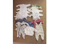 17 Baby sleep suits and a couple of vests. 0-3 months