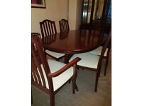 Dining table 6 chairs (2 carvers) and matching display cabinet in excellent condition.
