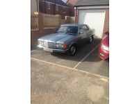 Classic mercedes 230CE pillarless coupe