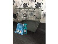 Medium dog cage, puppy pads, training spray