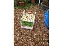 Wooden baby walker with integrated activity centre