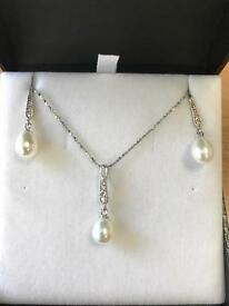 Silver pearl necklace and earring set