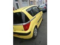 Yellow peudeot 1007