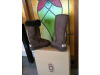 UGG boots. Chocolate brown. High style. Sz 4:1/2. Never worn. Boxed and wrapped