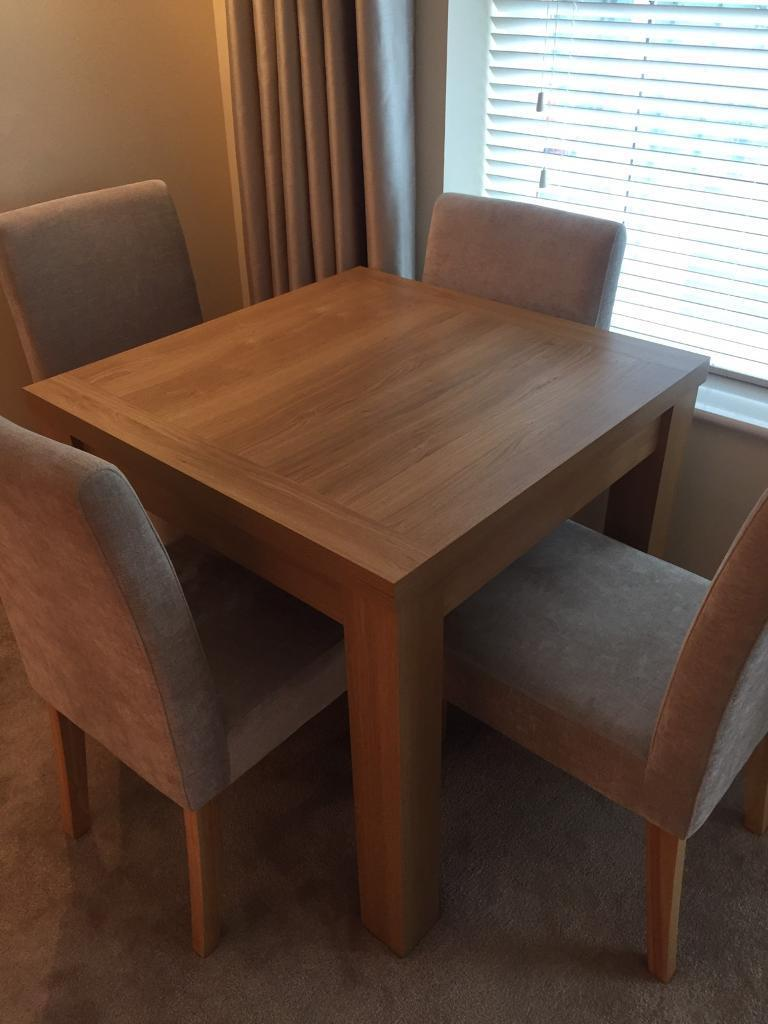 Square to rectangle oak dining table from next