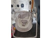 Grey and white striped baby swing nearly new used a hand full of times
