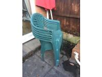 Plastic garden table and six chairs
