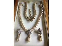 Gorgeous white pearls gold plated necklace earring set,