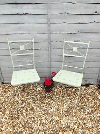 A pair of Vintage wrought iron folding garden chairs
