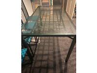 Black and glass dining table with 8 tall backed chairs. Open to offers