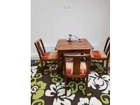 Table and chairs with rug