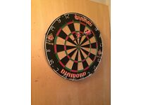Dart board (mounted on wood)