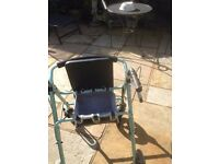 Rollator mobility walking trolley with seat, storage and brakes. Folds to go in a car boot