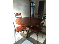 Round Wooden/Cast Iron Dining Table and Four Chairs