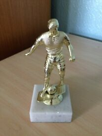 Gold Football Trophy on White Marble Base