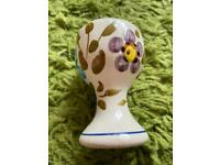 One egg cup - 3 different coloured flowers on the design