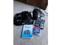 Canon E400 digital camera with many useful accessories