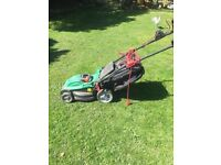 Qualcast electric lawnmower. With long cable. Height adjustable for low or high cuts.