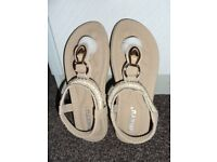 this is a beautiful pair of Sandals,extemely well made and full of quality.Also stretchy back strap.