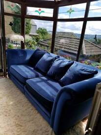 2 blue plush sofas