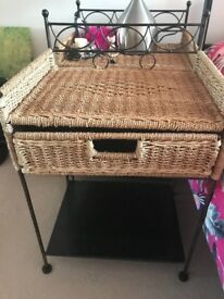 Wicker and iron bedside tables