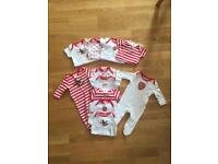 Selection of Arsenal baby grows and vests