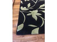 Black and green very thick rug